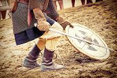 stock photo of jousting  - Warrior with a sworn during Historical Reconstruction of the Medieval knights Tournament