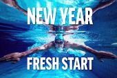 foto of breast-stroke  - Fit swimmer training by himself against new year fresh start - JPG