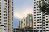 stock photo of upstairs  - modern upstairs residential buildings in Singapore city by evening - JPG