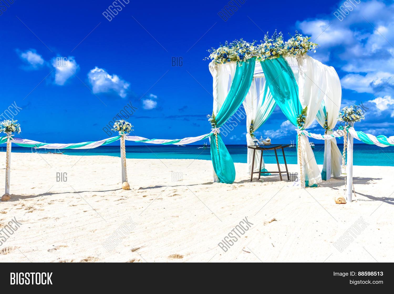 Beach Wedding Venue Setup Cabana Arch Gazebo Decorated With Flowers