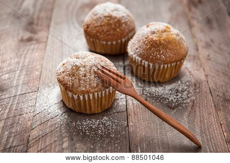 Muffins And Fork On A Wooden Table