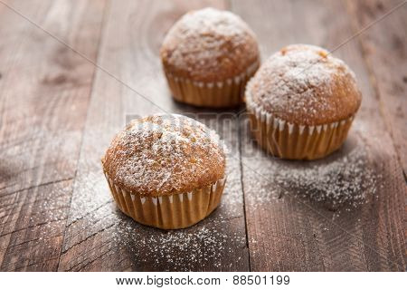 Homemade Muffins On A Wooden Table