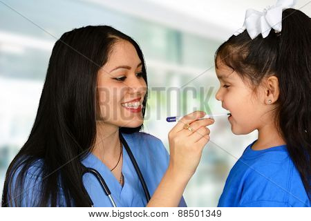 Young female nurse checking up little girl