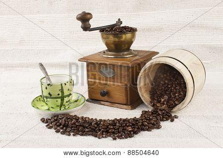 spilled coffee beans, coffee mug, old coffee grinder
