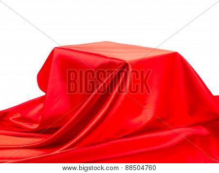 Box in red silk fabric.