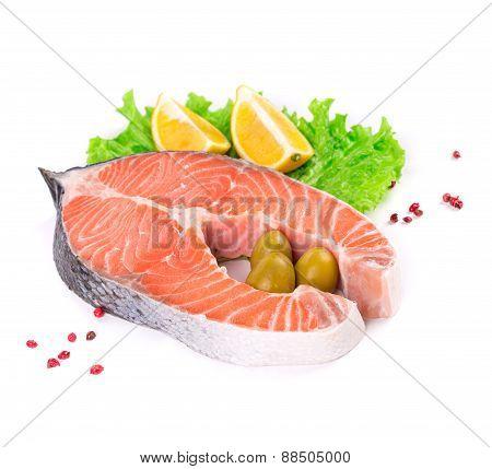 Raw salmon with garnish.