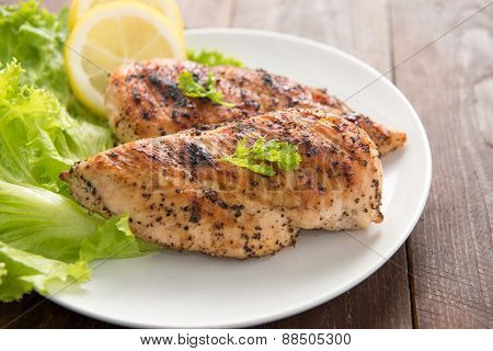 Marinated Grilled Chicken Breasts Cooked Bbq And Served With Fresh Herbs And Lemon