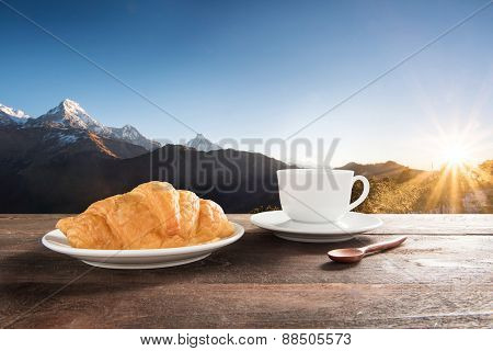 Fresh Baked Croissants And Coffee On A Wooden Table At Mountain View