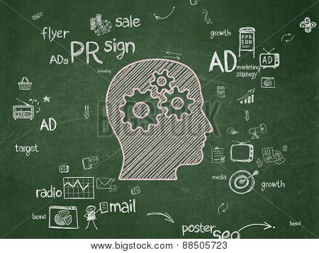 Marketing concept: Head With Gears on School Board background