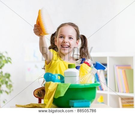 Joyful little girl cleanses a floor
