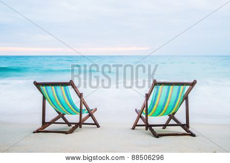 Lounge chairs on a tropical beach at summer