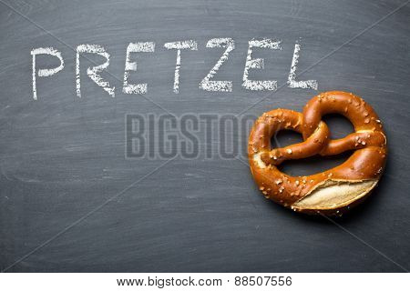 the baked pretzel on a chalkboard