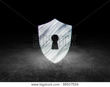 Safety concept: Shield With Keyhole in grunge dark room