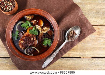 Mushroom soup on wooden table, top view