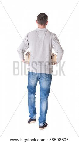 man goes and has a stack of books. back view. Rear view people collection.  backside view of person.  Isolated over white background.