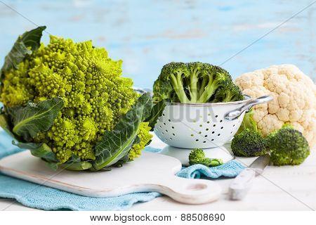 Various types of cabbage: romanesco, broccoli and cauliflower