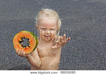 Little Cute Girl On The Sea Beach With Sweet Orange Papaya