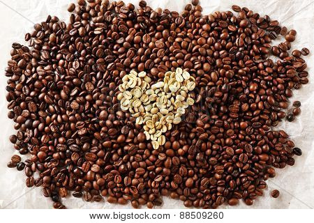 Coffee beans on crumpled parchment