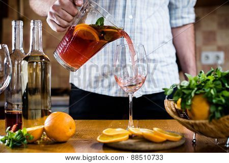 Man pours home sangria