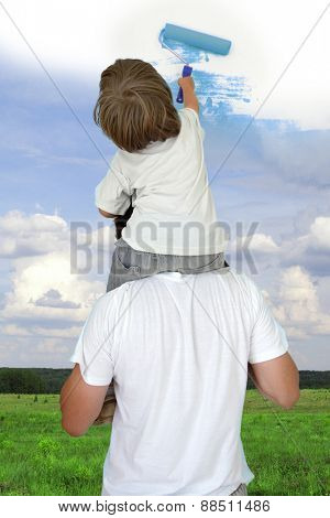 Dad helping son to draw good weather collage