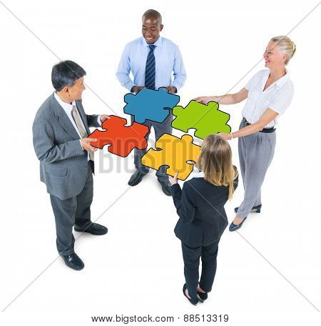 Group of Business People Connecting Jigsaw Puzzles