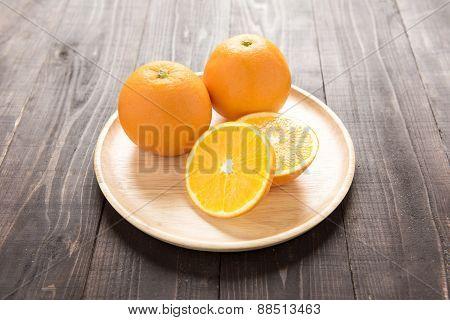 Fresh Oranges On Wooden Dish, Fresh Fruits On Wooden Background.