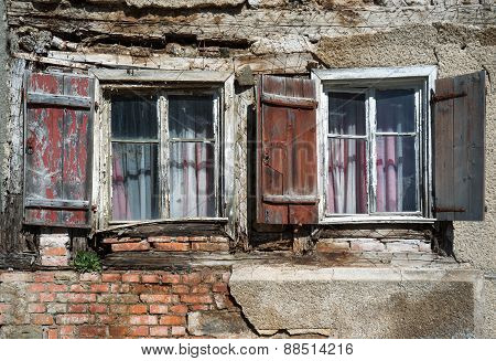 Two windows in the ruin of a house