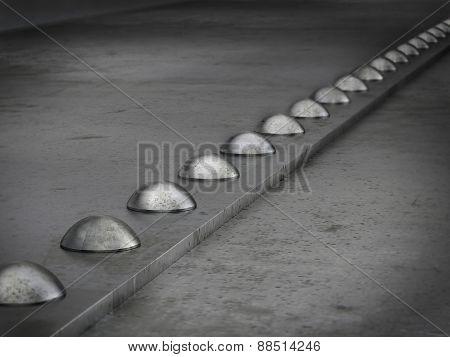 Row of rivets on the metal grunge background