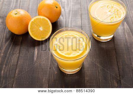 Orange Juice And Orange On The Wooden Background