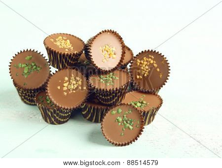 Tasty chocolate candies on wooden table