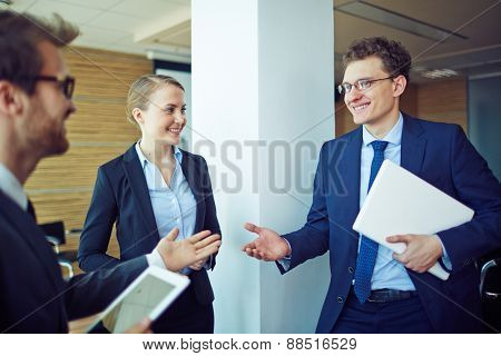 Group of managers interacting in conference hall at break
