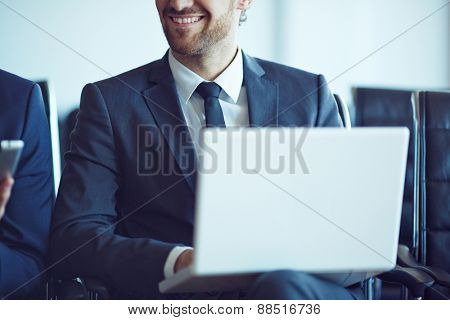 Male employee working with laptop