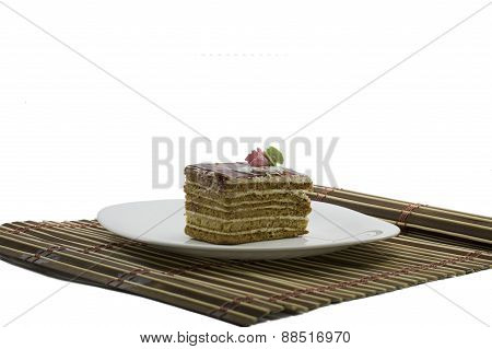 Beige Cake On A White Plate, On A Rug