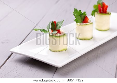 Cucumber rolls on white plate