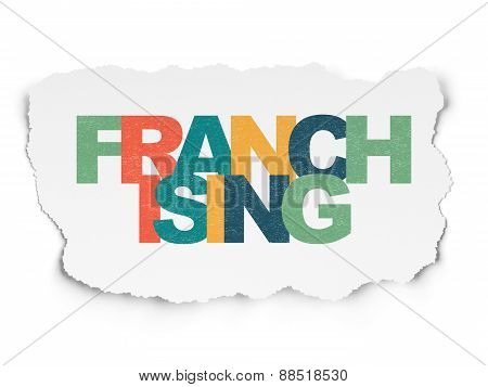 Finance concept: Franchising on Torn Paper background