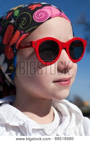 Young Girl In Sunglasses