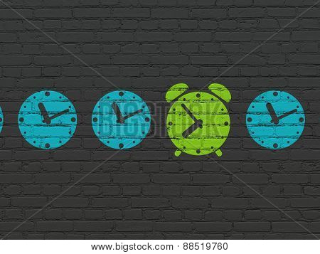Timeline concept: green alarm clock icon on wall background