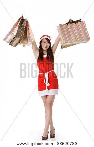Asian Christmas girl shopping and holding bags, full length portrait on white background.