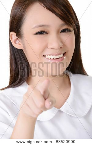 Asian nurse point at you on white background.