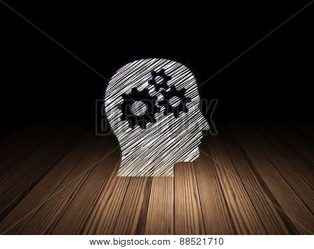 Education concept: Head With Gears in grunge dark room