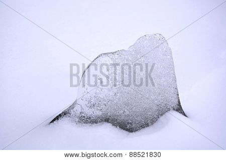 A Piece Of Ice In The Snow