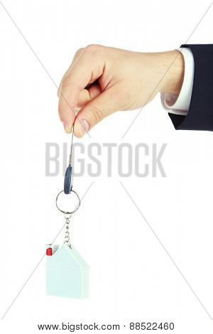 Hand with key isolated on white