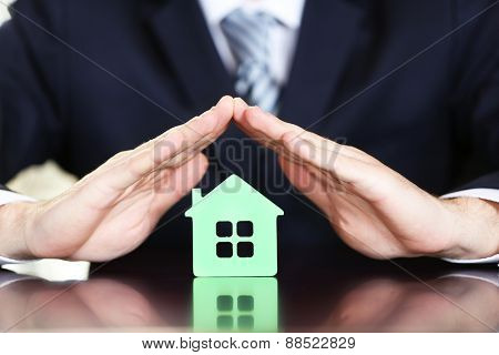 Male hands with model of house, closeup