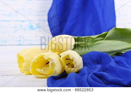 Beautiful bouquet of yellow tulips on wooden background