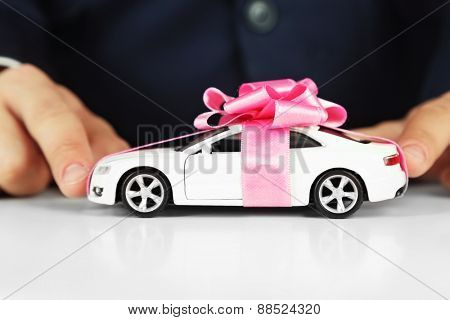 Man holding model of car in his hands