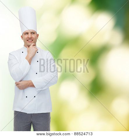 cooking, profession, inspiration and people concept - happy male chef cook thinking over green background