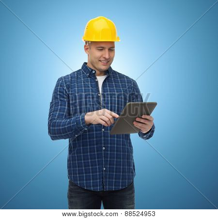 repair, construction, building, people and maintenance concept - smiling male builder or manual worker in helmet with tablet pc computer over blue background