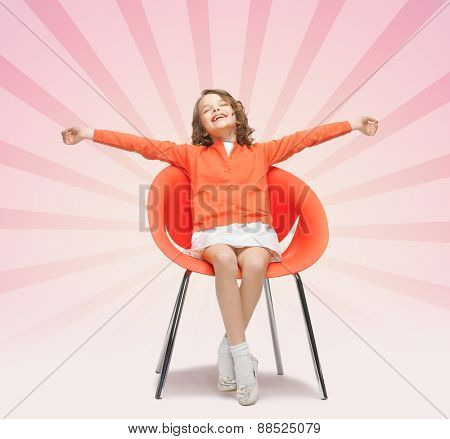 people, happiness, childhood and furniture concept - happy little girl sitting on designer chair over pink burst rays background