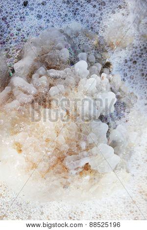 Crystals of sea salt from Dead Sea coast, close-up