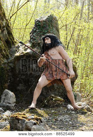 Homo Sapiens Statue Holding Hunting Tool